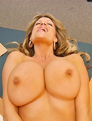 Kelly Madison takes a big cock in her mouth in...