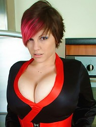 Tattooed Dors Feline gets naked in the kitchen