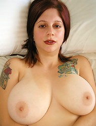 Young sensual Maggy showing off her heavy...