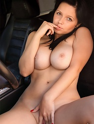 Busty babe strips off and masturbates in a hummer