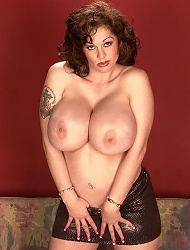Chubby agnes plays with her giant jugs in a...